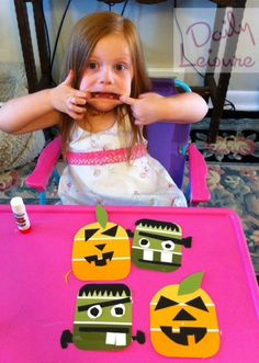 What to do with those old paint swatches from the hardware store.  Make Halloween crafts, of course.