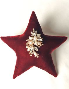 DIY Large Velvet Star Ornament with Vintage Brooch from mrspollyrogers.com.  Cute video, too!