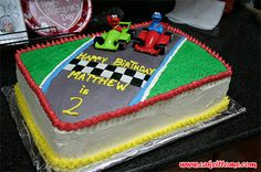 Cake Designs for Kids Birthdays -  Elmo and Cookie Monster Race Cake #cakedesigns