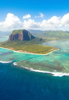 Mauritius - Le Morne Cultural Landscape. UNESCO World Heritage Site. The rugged mountain that juts into the ocean was used as a shelter by runaway slaves through the 18th and early 19th centuries. They formed small settlements in the caves and on its summit. BelAfrique - Your Personal Travel Planner - www.belafrique.com