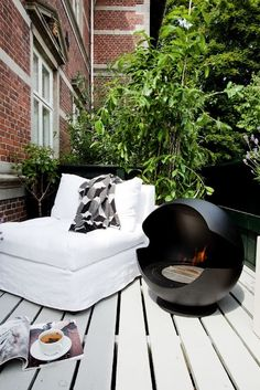 33 Amazing Small Terrace Design Ideas : 33 Amazing Small Terrace Design Ideas With Black White Sofa And Portable Fireplace And Wooden Floor