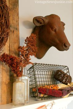 Love this rusty Cow head for Fall! From Vintage News Junkie Blog.