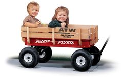 The Original Little Red Wagon with high wooden stake sides and big, brawny air tires that can handle any terrain.