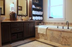 Master Bathroom idea. LIKE THE SHELVE FOR TOWELS AND WE SHOULD TAKE THE BIG MIRROR DOWN AND PUT UP  TWO SMALLER MIRRORS