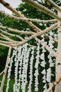 paper cone backdrop, photo by Emily Delamater http://ruffledblog.com/marianmade-farm-wedding #weddingideas #backdrops #diy