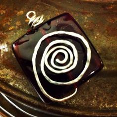 Raspberry stone wrapped with silver wire pendant