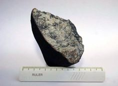 Chelyabinsk Meteorite May Have Collided with Another Body in Solar System Aug 27, 2013 by Sci-News.com According to a team of Russian scientists reporting today at the Goldschmidt conference in Italy, the Chelyabinsk meteorite either collided with another body or came too close to the Sun before it fell to our planet. This is a fragment of the Chelyabinsk (Laboratory of Meteoritics, Vernadsky Institute, Russia).