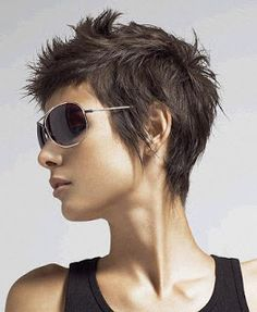 Short Haircut with disconnect and fringy around the hairline leaves it very feminine and youthful!