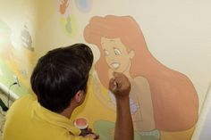 "Nick Pitera working on the ""Magical Nursery"" for his friends Henry and Laura"