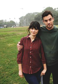 Zooey Deschanel and Jake Johnson. Jake is rather cute!