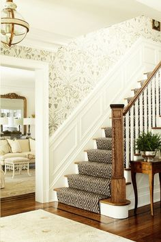 Marie Flanigan Interiors.  love the patterned runner and wallpaper on the stairs.