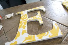 I am so doing this! Super easy fabric covered wooden letters!