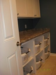*laundry room with laundry basket organization - i want room for this - so easy to fold the clothes and place them in the baskets for each family member. also, good idea to store bed linens in the laundry room - as you bring your dirty linens/sheets/blankets in for washing - pick up your clean ones  head back to your bedroom.