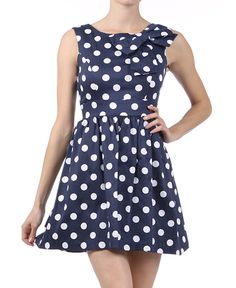 Navy and white polka dot dress with oversized bow. Makes me want to go sailing!