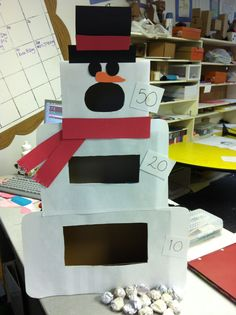 PRIMARY SINGING TIME IDEA: Snowman game. Use balled up scrap paper to throw as snowballs and different sized tissue boxes to make body.