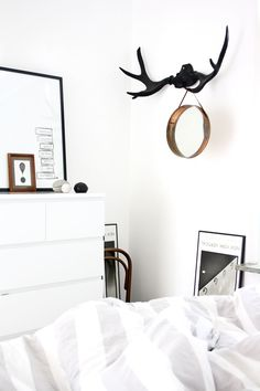 Copper mirror hanging from antlers