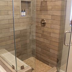 Faux wood tile in shower. Visit Just Floors in Westfield IN to design the shower of your dreams.