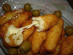 Bolinho de arroz com queijo (fried rice and cheese balls)