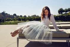 Credit: Patrick Fraser for the Observer Emilia wears awhite silk top by Jonathan Simkhai and blue tulle skirt by Vivienne Westwood
