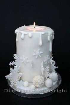 Its a cake! White winter wedding cake with a candle as a topper