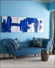 Blue couch, blue wall