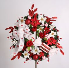 Berries, candies, carnations, poinsettias