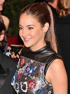 SHAILENE WOODLEY'S HIGH-FASHION PONY Not just for the gym, a simple and sleek ponytail is the perfect complement to a futuristic and youthful dress like Shailene's. The key to keeping it from coming off as too casual, according to Jamal Hammadi, the stylist who created this look, is to use serum before blowing out the hair (he likes Hamadi Healing Serum). Then flatiron the strands and finish with hair spray.