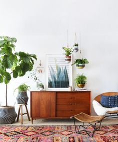 Rattan furniture, woven baskets and mid-century sideboard. Seventies inspired living room. More decorating ideas at www.redonline.co.uk