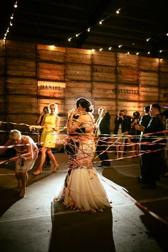 wrapping the newlyweds in streamers, photo by Love Katie + Sarah http://ruffledblog.com/fruit-packing-shed-wedding #weddingideas