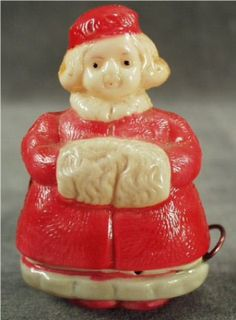 Old, Figural Girl with Winter Muff Celluloid Tape Measure