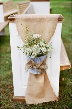burlap, galvanized pail and white flower rustic aisle decor and white church pews for outdoor wedding | photo: www.jhendersonstudios.com