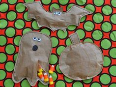 These fun paper shapes, packed with candy, are perfect to hand out to trick-or-treaters or for school parties.
