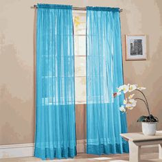 Bright sheer voile curtain panels will brighten any room in your home. These sheer curtains are great in kid's rooms.  #Kids #Curtains #Swags #Galore