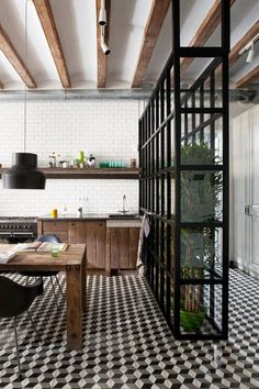 glass wall with plants - barcelona kitchen by  Egue y Seta