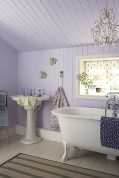 Very pretty lilac and pale sage green country-style bathroom.