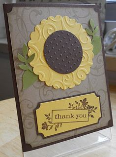 sunflower made with scalloped circle, embossed with divine swirls and centered with brown circle embossed with swiss dots. maybe use deeper cut on yellow part