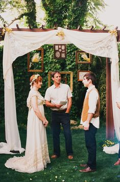 hanging frames for a backyard wedding ceremony // photo by made u look