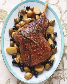 Cook new potatoes and olives alongside the lamb -- Braised Leg of Lamb with Potatoes and Olives Recipe