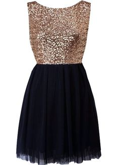 Midnight Frost Dress: Features a glittering gold sequin bodice with deep V-design to the back, flowy navy blue chiffon skirt, and an edgy exposed rear zipper to finish.