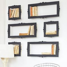 Paint a box the same color as the wall, stick a frame on it, and BOOM! Coolest shelf EVER!