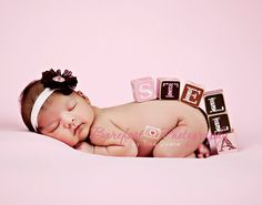 Love this pose with the blocks spelling out her name hugging her bottom