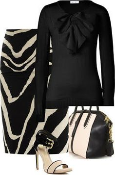 This beige and black combination is a flattering fall outfit that could be great for work. The way it would flow off of the hips makes it seem proper, yet the material would be quite comfortable. Whether working in the studio or going out to meet a client, this is an ideal outfit for a fashion designer on the go.