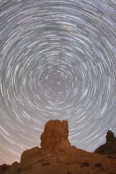 """""""Starry Night Sky,"""" by Nicole Sullivan. Runner-up for Young Astronomy Photographer of the Year 2011. Star trails are produced in a photo when the camera isn't set to track objects in the sky to compensate for the movement of the Earth. Nicole's father was a winner in one of the competition categories. ©Mona Evans, """"Astronomy Photographer of the Year 2011"""" http://www.bellaonline.com/articles/art50195.asp"""