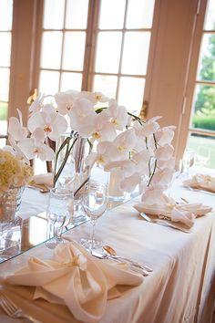 Orchid arrangement for a wedding reception   Michelle VanTine Photography   Brides.com