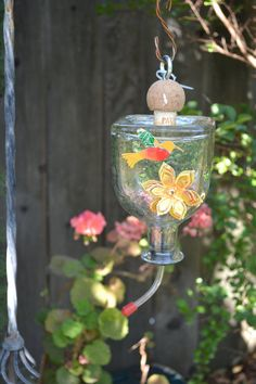 Cute homemade hummingbird feeders made from repurpused bottles and soda cans. Buy them here!!!