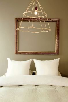 lovely light fixture and empty frame