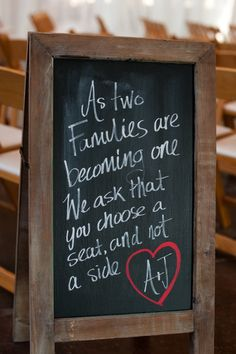"""""""As two familkies are becoming one, we ask that you choose a seat, not a side."""" Photography by aislinnrain.com, Planning by abigtodoevent.com, Floral Design by bytulip.com"""