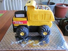 Tonka truck cake.  Covered in buttercream, they asked for little to no fondant which I would have preferred to cover this with.  Thanks for ... boy cake