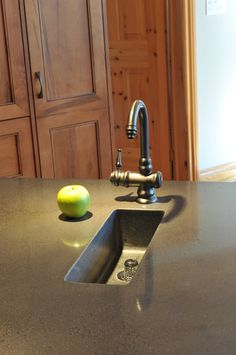 Polished cement counter tops with custom serving sink.