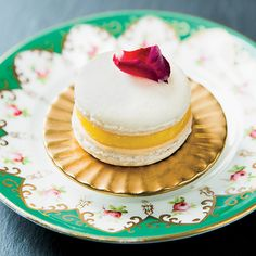 Caitlin Freeman's Lemon Curd Macaron featured in Beautiful Art-Inspired Desserts | Food & Wine. The dessert was inspired by Young Girl with Ruffled Collar.